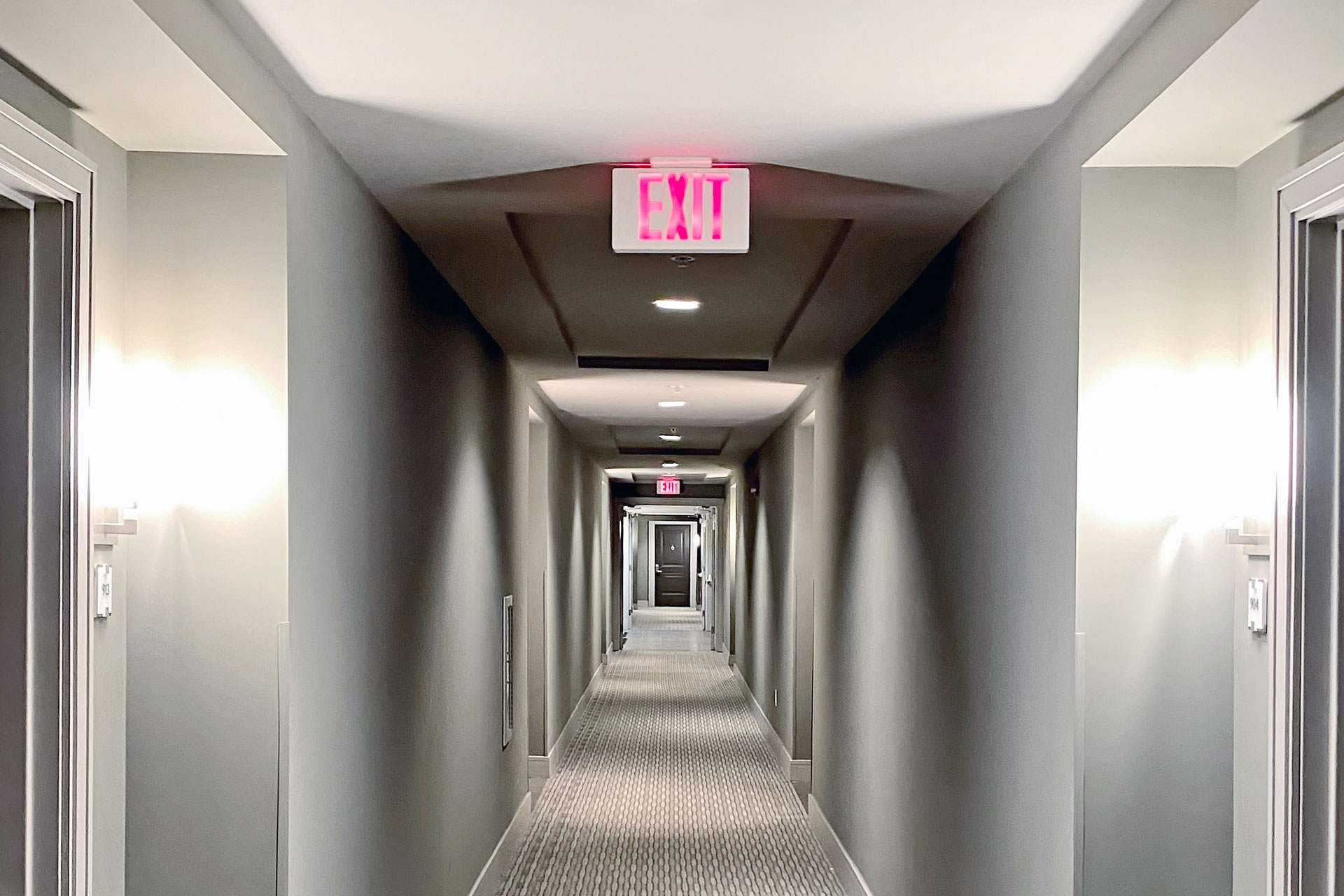 hallway with exit sign